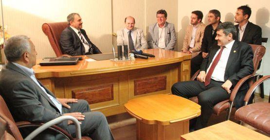 Bakan Eroğlu'na AGC'den basın kartı